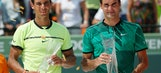While tennis heads to clay, Roger Federer heads for vacation