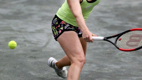 Katerina Siniakova, of the Czech Republic, plays Monica Puig, of Puerto Rico, at the Volvo Car Open in Charleston, S.C., Monday, April 3, 2017. (Grace Beahm/The Post And Courier via AP)