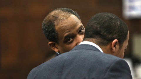 While making oral arguments before Judge Jeffrey Locke, defense attorney Ronald Sullivan, left, confers with legal intern Jeohn Favors Tuesday, April 4, 2017, during the trial of former New England Patriots tight end Aaron Hernandez in Suffolk Superior Court in Boston.  Hernandez is standing trial for the July 2012 killings of Daniel de Abreu and Safiro Furtado, who he encountered in a Boston nightclub. The former NFL player is already serving a life sentence in the 2013 killing of semi-professional football player Odin Lloyd.  (Pat Greenhouse/The Boston Globe via AP, Pool)