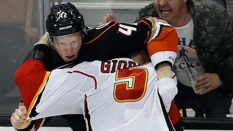 Anaheim Ducks defenseman Josh Manson, left, fights Calgary Flames defenseman MarkGiordano during the third period of an NHL hockey game in Anaheim, Calif., Tuesday, April 4, 2017. The Ducks won 3-1. (AP Photo/Alex Gallardo)