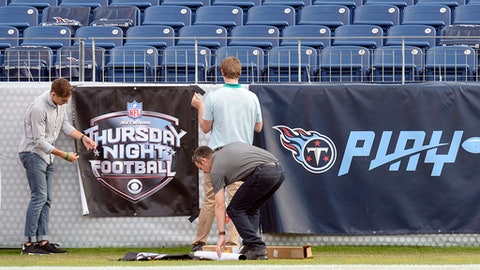 A Thursday Night Football banner is put up in Nissan Stadium before an NFL football game between the Tennessee Titans and the Jacksonville Jaguars Thursday, Oct. 27, 2016, in Nashville, Tenn. (AP Photo/Mark Zaleski)