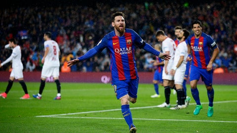 FC Barcelona's Lionel Messi celebrates after scoring during the Spanish La Liga soccer match between FC Barcelona and Sevilla at the Camp Nou stadium in Barcelona, Spain, Wednesday, April 5, 2017. (AP Photo/Manu Fernandez)