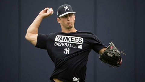 FILE - In this Feb. 14, 2017, file photo, New York Yankees James Kaprielian throws during a spring training baseball workout in Tampa, Fla. Top Yankees pitching prospect James Kaprielian was placed on the minor league disabled list because of pain in his right elbow and will be sent for scans. The Yankees said Thursday, April 6, 2017, that the 23-year-old right-hander, taken with the 16th overall pick in the 2015 amateur draft, will have an MRI and a dye contrast MRI.(AP Photo/Matt Rourke, File)