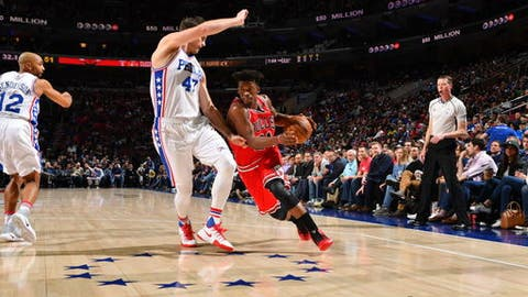 PHILADELPHIA,PA -  APRIL 6 : Jimmy Butler #21 of the Chicago Bulls drives to the basket against the Philadelphia 76ers at Wells Fargo Center on April 6, 2017 in Philadelphia, Pennsylvania NOTE TO USER: User expressly acknowledges and agrees that, by downloading and/or using this Photograph, user is consenting to the terms and conditions of the Getty Images License Agreement. Mandatory Copyright Notice: Copyright 2017 NBAE (Photo by Jesse D. Garrabrant/NBAE via Getty Images)