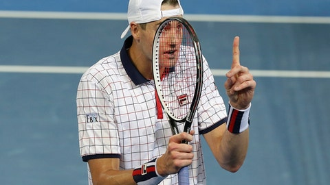 John Isner of the United States reacts to a call by the umpire in his match against Nick Kyrgios of Australia at the Davis Cup World Group Quarterfinal in Brisbane, Australia, Friday, April 7, 2017. (AP Photo/Tertius Pickard)