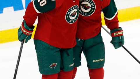 FILE - In this Oct. 22, 2015 photo, Minnesota Wild's Zach Parise, right, and Ryan Suter celebrate Parise's goal against the Columbus Blue Jackets in an NHL hockey game in St. Paul, Minn. Forever linked as the players who lifted the franchise's profile around the league, the duo's leadership will be counted on this spring as the Wild try to reach the Stanley Cup finals for the first time. (AP Photo/Jim Mone,File)