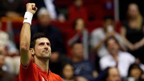 Serbia's Novak Djokovic celebrates after having won his Davis Cup quarterfinal tennis match against Spain's Albert Ramos-Vinolas, in Belgrade, Serbia, Friday, April 7, 2017. (AP Photo/Darko Vojinovic)