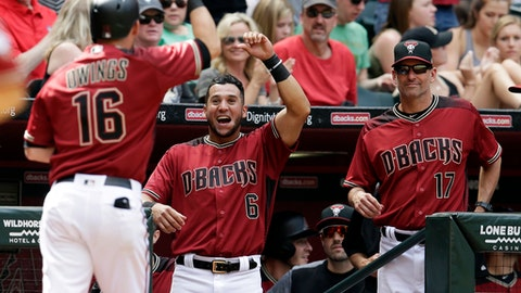 Arizona Diamondbacks' Chris Owings (16) celebrates with David Peralta (6) and manager Torey Lovullo (17) after hitting a solo home run against the Cleveland Indians in the sixth inning of a baseball game, Sunday, April 9, 2017, in Phoenix. (AP Photo/Rick Scuteri)