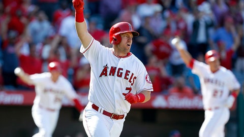 Los Angeles Angels' Cliff Pennington (7) celebrates after getting the game-winning hit in the ninth inning of a baseball game against the Seattle Mariners, Sunday, April 9, 2017, in Anaheim, Calif. The Angels won 10-9. (AP Photo/Christine Cotter)