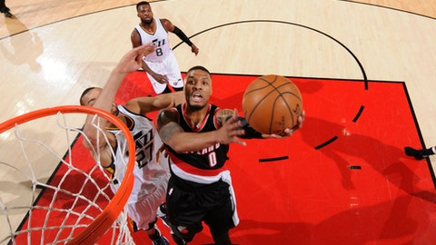 PORTLAND, OR - APRIL 8: Damian Lillard #0 of the Portland Trail Blazers shoots the ball against the Utah Jazz on April 8, 2017 at the Moda Center in Portland, Oregon. NOTE TO USER: User expressly acknowledges and agrees that, by downloading and or using this Photograph, user is consenting to the terms and conditions of the Getty Images License Agreement. Mandatory Copyright Notice: Copyright 2017 NBAE (Photo by Cameron Browne/NBAE via Getty Images)