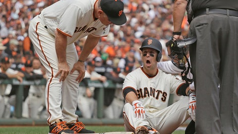 Giants catcher Buster Posey struck in head by pitch in win