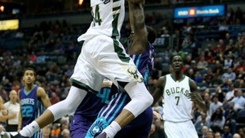 MILWAUKEE, WI - APRIL 10:  Giannis Antetokounmpo #34 of the Milwaukee Bucks attempts a layup while being guarded by Marvin Williams #2 of the Charlotte Hornets in the first quarter at BMO Harris Bradley Center on April 10, 2017 in Milwaukee, Wisconsin. NOTE TO USER: User expressly acknowledges and agrees that , by downloading and or using this photograph, User is consenting to the terms and conditions of the Getty Images License Agreement. (Photo by Dylan Buell/Getty Images)