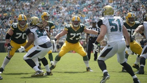 Green Bay Packers guard T.J. Lang (70), center JC Tretter (73) and guard Lane Taylor (65) block for quarterback Aaron Rodgers against Jacksonville Jaguars defensive tackle Tyson Alualu (93) and middle linebacker Paul Posluszny (51) during the second half of an NFL football game in Jacksonville, Fla., Sunday, Sept. 11, 2016. The Packers won 27-23. (AP Photo/Phelan M. Ebenhack)