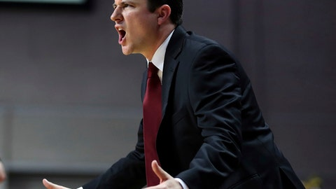 """FILE - In this March 11, 2017, file photo, New Mexico State coach Paul Weir yells to his team during the second half of an NCAA college basketball game against Cal State Bakersfield in the final of the Western Athletic Conference tournament, in Las Vegas. New Mexico looked to its own backyard for a new men's basketball coach by hiring NMSU head coach Paul Weir to lead the Lobos. """"In conducting this search, his was a name that was on our radar from the beginning,"""" New Mexico athletic director Paul Krebs said in a statement Tuesday, April 11, 2017,  announcing Weir's hiring. (AP Photo/L.E. Baskow, File)"""