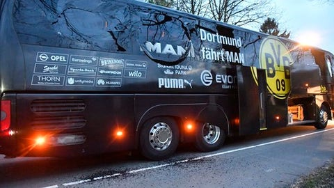 A window of Dortmund's team bus is damaged after an explosion before the Champions League quarterfinal soccer match between Borussia Dortmund and AS Monaco in Dortmund, western Germany, Tuesday, April 11, 2017.  (AP Photo/Martin Meissner)