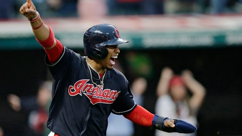 Cleveland Indians' Francisco Lindor celebrates after scoring on a one-run double hit by Michael Brantley in the tenth inning of a baseball game against the Chicago White Sox, Tuesday, April 11, 2017, during opening day in Cleveland. The Indians won 2-1 in 10 innings. (AP Photo/Tony Dejak)