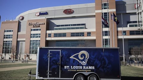 A merchandise trailer sits outside the Edward Jones Dome, former home of the St. Louis Rams, Wednesday, Jan. 13, 2016, in St. Louis. NFL owners voted on Tuesday to move the Rams from St. Louis to Los Angeles starting with the 2016 season. (AP Photo/Jeff Roberson)