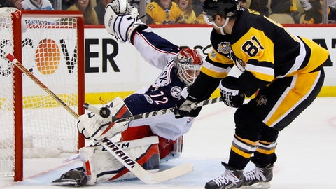 Columbus Blue Jackets goalie Sergei Bobrovsky (72) stops a shot by Pittsburgh Penguins' Phil Kessel (81) during the second period in Game 1 of an NHL first-round hockey playoff series in Pittsburgh, Wednesday, April 12, 2017. (AP Photo/Gene J. Puskar)
