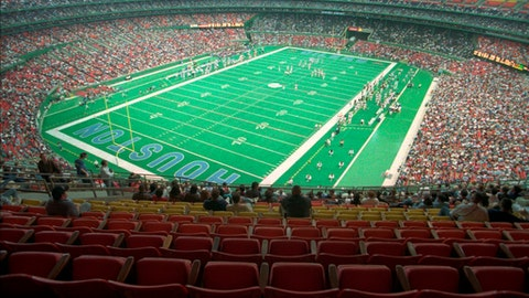 FILE - In this Nov. 12, 1995, file photo. nearly half the seats were empty in Houston's Astrodome as the Houston Oilers play the Cincinnati Bengals in an NFL football game. Oilers owner Bud Adams has cited lack of fan interest as one of his reasons for moving the team to Nashville, Tenn. (AP Photo/Michael Stravato, File)