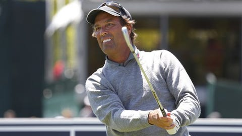 Stephen Ames his a tee shot on the 17th hole during the second round of the 75th Senior PGA Championship golf tournament at Harbor Shores Golf Club in Benton Harbor, Mich., Friday, May 23, 2014. (AP Photo/Paul Sancya)