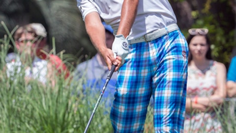 Ian Poulter, of England, drives his shot off the second tee during the final round of the RBC Heritage golf tournament in Hilton Head Island, S.C., Sunday, April 16, 2017. (AP Photo/Stephen B. Morton)