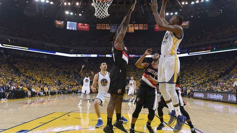 Durant shines in Warriors playoff debut in Game 1 win