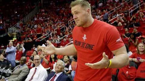 Houston Texans J.J. Watt watches before Game 1 of an NBA basketball first-round playoff series between the Houston Rockets and the Oklahoma City Thunder, Sunday, April 16, 2017, in Houston. (AP Photo/David J. Phillip)