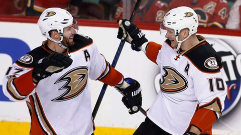 Anaheim Ducks' Corey Perry, right, celebrates his overtime goal against the Calgary Flames with Ryan Kesler during overtime in Game 3 of a first-round NHL hockey Stanley Cup playoff series in Calgary, Alberta, Monday, April 17, 2017. (Larry MacDougal/The Canadian Press via AP)