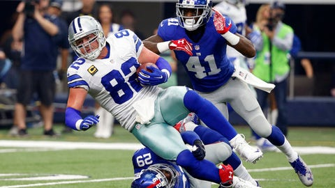 FILE - In this Sept. 11, 2016, file photo, Dallas Cowboys tight end Jason Witten (82) is tackled after a catch by New York Giants free safety Nat Berhe (29) and cornerback Dominique Rodgers-Cromartie (41) during an NFL football game in Arlington, Texas. Dallas tried unsuccessfully to draft an heir to tight end Jason Witten, whiffing on second-round pick Gavin Escobar. Witten is signed through 2021 but realistically has only a couple seasons left. (AP Photo/Michael Ainsworth, File)