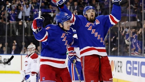 New York Rangers' Rick Nash, left, celebrates with teammate Jimmy Vesey, center, as Montreal Canadiens goalie Carey Price, left, reacts during the second period of an NHL hockey game in Game 4 of an NHL hockey first-round playoff series Tuesday, April 18, 2017, in New York. (AP Photo/Frank Franklin II)