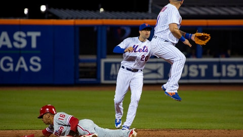 Philadelphia Phillies' Cesar Hernandez steals second base as New York Mets' Neil Walker (20) and Asdrubal Cabrera look for the throw during the third inning of a baseball game Tuesday, April 18, 2107, in New York (AP Photo/Craig Ruttle)