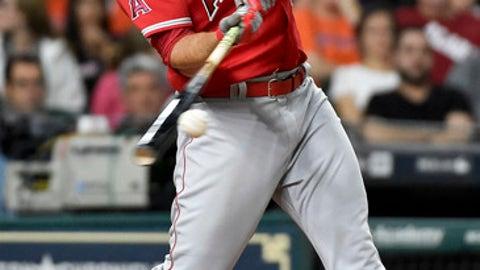 Los Angeles Angels' Mike Trout hits an RBI double in the fifth inning of a baseball game against the Houston Astros, Tuesday, April 18, 2017, in Houston. (AP Photo/Eric Christian Smith)