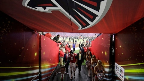 FILE - In this Feb. 5, 2017, file photo, Atlanta Falcons' Matt Ryan walks back to the locker room after the NFL Super Bowl 51 football game loss to the New England Patriots in overtime, in Houston. Time for the Falcons to move on. The team begins offseasoon workouts with an eye toward getting over a stunning Super Bowl loss.  (AP Photo/Tony Gutierrez, File)
