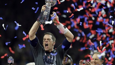 "FILE - In this Feb. 5, 2017, file photo, New England Patriots' Tom Brady raises the Vince Lombardi Trophy after defeating the Atlanta Falcons in overtime at the NFL Super Bowl 51 football game, in Houston. Brady will not join his New England Patriots teammates when the Super Bowl champions visit the White House on Wednesday, April 19, 2017, to accept congratulations from President Donald Trump for another NFL title.  The White House said it was notified that Brady was dealing with a ""personal family matter"" and will not attend the ceremony.  (AP Photo/Darron Cummings, File)"