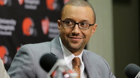 """FILE - In this Jan. 13, 2016, file photo, Cleveland Browns Executive Vice President of Football Operations, Sashi Brown, addresses the media during a news conference in Berea, Ohio. The Browns are inclined to keep the No. 1 overall pick in next week's NFL draft despite getting offers for it. Sashi Brown said Wednesday, April 19, 2017, that the Browns """"feel really good about drafting No. 1."""" (AP Photo/Tony Dejak, File)"""