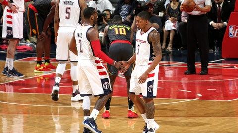 WASHINGTON, DC -  APRIL 19: Bradley Beal #3 and John Wall #2 of the Washington Wizards high five each other during the game against the Atlanta Hawks during Game Two of the Eastern Conference Quarterfinals during the 2017 NBA Playoffs on April 19, 2017 at Verizon Center in Washington, DC. NOTE TO USER: User expressly acknowledges and agrees that, by downloading and or using this Photograph, user is consenting to the terms and conditions of the Getty Images License Agreement. Mandatory Copyright Notice: Copyright 2017 NBAE (Photo by Stephen Gosling/NBAE via Getty Images)