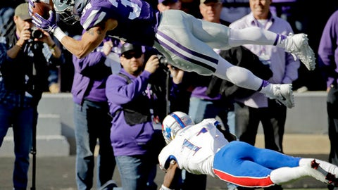 FILE - In this Nov. 26, 2016, file photo, Kansas State running back Alex Barnes (34) dives into the end zone over Kansas linebacker Mike Lee (11) to score a touchdown during an NCAA college football game in Manhattan, Kan. Even though Barnes ran for 100-plus yards in back-to-back weeks against Baylor and Kansas, scoring five touchdowns in those two games, the rising sophomore has several guys nipping at his heels heading into Saturday's annual Purple-White spring game at Bill Snyder Family Stadium. (AP Photo/Charlie Riedel, File)