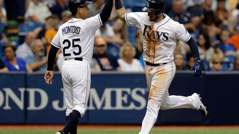 Tampa Bay Rays' Daniel Robertson, right, high-fives third base coach Charlie Montoyo as he runs around the bases after hitting a home run off Detroit Tigers' Warwick Saupold in the eighth inning of a baseball game Thursday, April 20, 2017, in St. Petersburg, Fla. (AP Photo/Chris O'Meara)