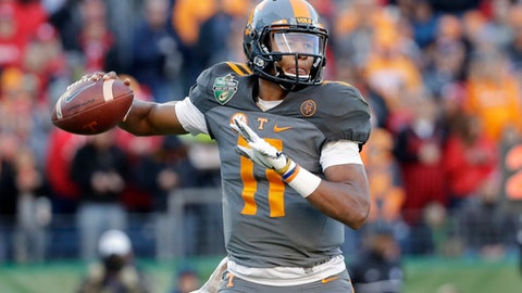 FILE - In this Dec. 30, 2016, file photo, Tennessee quarterback Joshua Dobbs passes against Nebraska in the first half of the Music City Bowl NCAA college football game, in Nashville, Tenn. Regarded as a potential late-round pick or free agent prior to his senior season, the aerospace engineering major now could hear his name called by the second night of the NFL Draft. (AP Photo/Mark Humphrey, File)