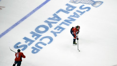 Washington Capitals left wing Alex Ovechkin (8), of Russia, and Dmitry Orlov (9), also of Russia, warm up before Game 5 in an NHL Stanley Cup hockey first-round playoff series against the Toronto Maple Leafs, Friday, April 21, 2017, in Washington. (AP Photo/Nick Wass)