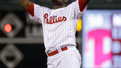 Philadelphia Phillies relief pitcher Hector Neris celebrates after striking out Atlanta Braves' Tyler Flowers to end a baseball game, Friday, April 21, 2017, in Philadelphia. (AP Photo/Matt Slocum)