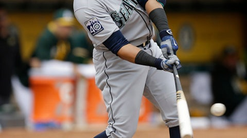 Seattle Mariners' Nelson Cruz hits a single off Oakland Athletics' Jharel Cotton in the first inning of a baseball game Saturday, April 22, 2017, in Oakland, Calif. (AP Photo/Ben Margot)