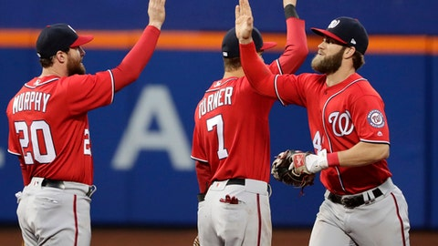 Washington Nationals' Bryce Harper (34) celebrates with teammates Trea Turner (7) and Daniel Murphy (20) after a baseball game against the New York Mets, Saturday, April 22, 2017, in New York. (AP Photo/Frank Franklin II)