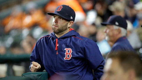 Boston Red Sox's Dustin Pedroia stands in the dugout in the third inning of a baseball game against the Baltimore Orioles in Baltimore, Saturday, April 22, 2017. Pedroia sat out the game after being injured on a play in Friday's game against Baltimore. (AP Photo/Patrick Semansky)