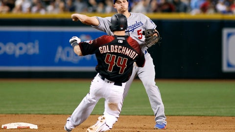 Los Angeles Dodgers second baseman Corey Seager (5) throws to first over Arizona Diamondbacks' Paul Goldschmidt to complete a double play on a ball hit by the Diamondbacks' Jake Lamb during the eighth inning of a baseball game, Saturday, April 22, 2017, in Phoenix. (AP Photo/Ralph Freso)