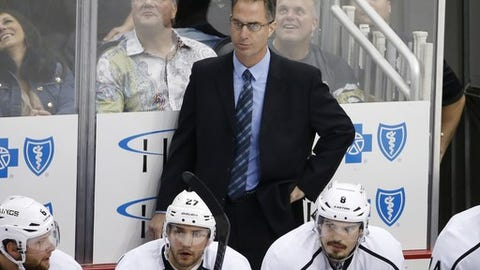 Los Angeles Kings assistant coach John Stevens stands behind his bench during the first period of an NHL hockey game against the Pittsburgh Penguins in Pittsburgh, Thursday, Oct. 30, 2014. The Penguins won 3-0. (AP Photo/Gene J. Puskar)