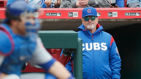 Chicago Cubs manager Joe Maddon stands in the dugout in the sixth inning of a baseball game against the Cincinnati Reds, Sunday, April 23, 2017, in Cincinnati. (AP Photo/John Minchillo)