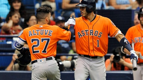 Houston Astros' Carlos Correa (1) congratulates Jose Altuve (27) after Altuve's solo home run off Tampa Bay Rays starter Matt Andriese during the fifth inning of a baseball game Sunday, April 23, 2017 in St. Petersburg, Fla. (AP Photo/Steve Nesius)
