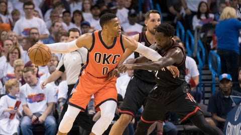 OKLAHOMA CITY, OK - APRIL 23:  Russell Westbrook #0 of the Oklahoma City Thunder and Patrick Beverley #2 of the Houston Rockets battle for the ball during the first half of Game Four in the 2017 NBA Playoffs Western Conference Quarterfinals on April 23, 2017 in Oklahoma City, Oklahoma. Oklahoma City defeated Houston 115-113   NOTE TO USER: User expressly acknowledges and agrees that, by downloading and or using this photograph, User is consenting to the terms and conditions of the Getty Images License Agreement. (Photo by J Pat Carter/Getty Images)
