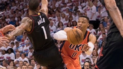 OKLAHOMA CITY, OK - APRIL 23:  Russell Westbrook #0 of the Oklahoma City Thunder passes the  ball as Trevor Ariza #1 of the Houston Rockets applies pressure during the second half of Game Four in the 2017 NBA Playoffs Western Conference Quarterfinals on April 23, 2017 in Oklahoma City. The Rockets defeated the Thunder 113-109. NOTE TO USER: User expressly acknowledges and agrees that, by downloading and or using this photograph, User is consenting to the terms and conditions of the Getty Images License Agreement. (Photo by J Pat Carter/Getty Images)